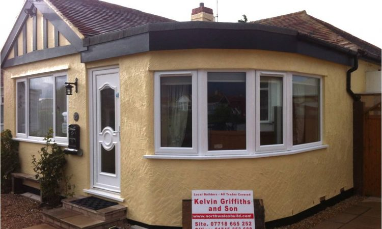 Curved Lounge extension with flat roof in Kinmel Bay